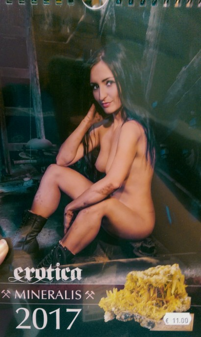 An erotic calender of pretty young women sitting underground.